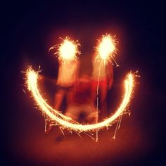Smiley face out of sparklers by Kate alec and me