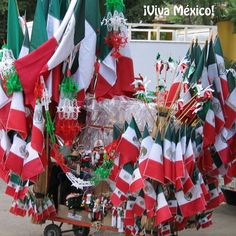 Find some trinkets, like the ones sold on this cart in a square in Mexico, to celebrate Mexican Independence Day!