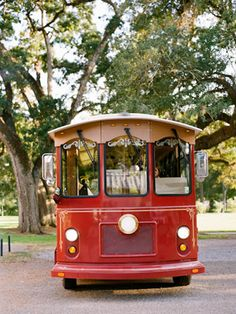 A red trolley - the perfect transportation vehicle for a very large wedding party - and super fun!  Makes a great backdrop for your photos as well!
