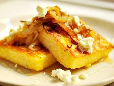 Griddled Polenta Cakes with Caramelized Onions, Goat Cheese and Honey (via Food 52 & Serious Eats)