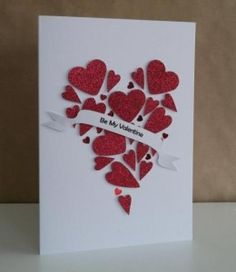 Red glittery hearts made into one heart hand made valentines card
