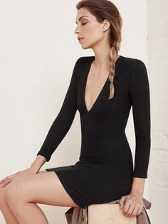 No more tights - time to let the legs out. This is a tight fitting dress with long sleeves and a deep v neckline.
