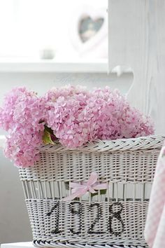 what a cute idea......house number on basket with flowers.