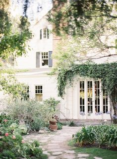 I love the stone path leading up to the french doors.