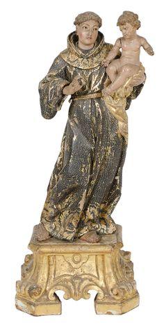 SANTO ANTONIO COM MENINO. Grupo sacro em madeira policromada. Alt.: 34cm. Portugal - séc. XIX. Perte