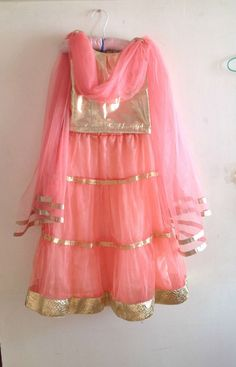 Etsy listing at https://www.etsy.com/listing/190777119/kids-gold-and-peach-lehenga