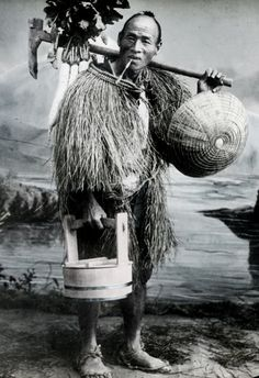 Farmer wearing straw rain-coat. Photo, about 1880's, Kobe, Japan, by T Takagi.
