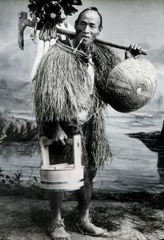 Farmer wearing straw rain-coat. Photo, about 1880's, Kobe, Japan, by T Takagi.