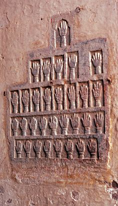 "These handprints represent women who comitted Sati (alternatively, suttee),  ""a funeral practice among some Hindu communities in which a recently-widowed woman would either voluntarily or by use of force and coercion immolate herself on her husband's funeral pyre."""