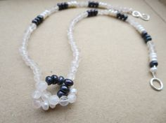 Check out this item in my Etsy shop https://www.etsy.com/uk/listing/205249502/pearl-quartz-necklace-pearl-necklace