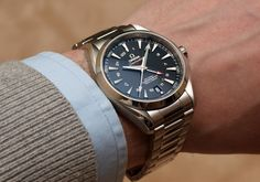 Omega Seamaster Aqua Terra GMT - on the wrist. At roughly 42mm case width, it wears larger than the understated design suggests.