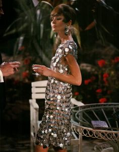 Audrey in a silver metal sequined mini dress designed by Paco Rabanne