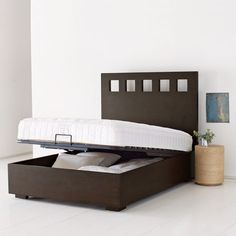 Cool concept. Pivot Storage Bed Frame from West Elm...store away bedding or anything else in the underbed hidden storage.
