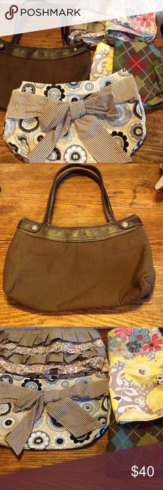 "Thirty-one brown  skirt purse with 5 skirts Thirty-one skirt brown  purse with 5 skirts, this purse has 5 different covers you can put on it to change the look, there is some wear on the corners of the purse, the yellow skirt has a mark on it as seen in the picture, 13"" across, 8.5"" down and 2"" wide, 1 zipper pocket with 1 slit pocket inside Thirty-one Bags"