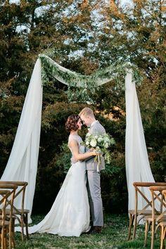 Simple Wedding Arbor With Greenery via kristynhogan