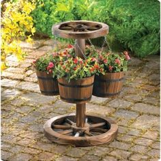 Rustic planter creates an instant oasis with a little country charm! Four buckets hold a quartet of your loveliest plants, suspended from a realistic wagon wheel center; well-weathered finish lends an antique look. http://www.wholesalemart.com/Wholesale-Garden-Planters-s/159.htm