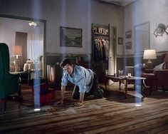 Love this light (though for me, it is more interesting unmotivated by the wholes in floor) by gregory crewdson