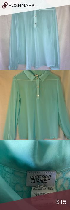 Charming Charlie blue blouse Charming Charlie blue blouse with three bottoms running down the shirt there's also a lace design in the back of the shirt the shirt is 100% polyester it's 25 inches long and the arm length is 26 inches long Charming Charlie Tops Blouses
