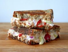 Grilled Cheese Social: The As If - @Wisconsin Cheese Gruyere, Swiss, cherry peppers, yellowfin tuna filets, empire mayo's black garlic mayo, red onions, celery, and everything seed bread