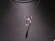 14k white gold and diamond angel necklace