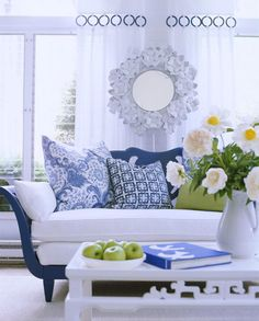 Blue-and-White Solarium  Textures, shades, and tints reign in this blue-and-white solarium highlighted by a cobalt-painted wood chaise with white matelassé cushions. Throw pillows add different shades and patterns of blue to the mix, while a white Chinoiserie coffee table and hammered metal appeal to the sense of touch.