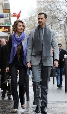 When he isn't ordering troops to take out civilians, President Bashar Al-Assad of Syria enjoys wearing smart scarves while out on the town with his wife. Autocratic #style.