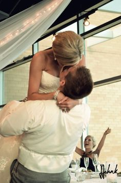 Instead of clinking glasses, bride and groom requested couples come up and introduce themselves and kiss each other. Then the bride and groom had to re-create that same kiss! Too cute :)