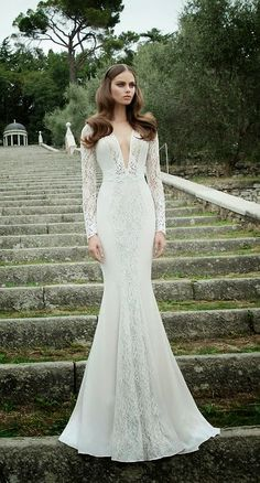 Long sleeves and deep cleavage- Berta Bridal
