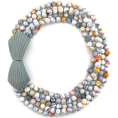 Finds Joy in the Ordinary {Beads of faceted fire agate (the bits of mint, orange, gray, blue, yellow, and lavender that show through the milky surface of the stone are amazing!)