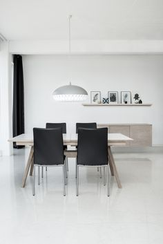 Mid century modern wood dining table in white oak with white laminate top sm11. Black leather dining chairs with steel metal legs sm58. Modo wall mounted floating stirage cabinets. #midcenturymoderndining #skovbyfurniture #modernwoodfurniture