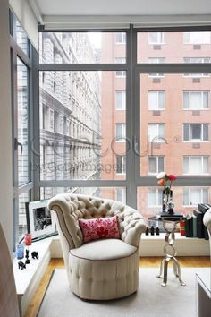 Olivia Palermo's Apartment: Buildings give such a dynamic backdrop - using the ledge for accents gives it charm.