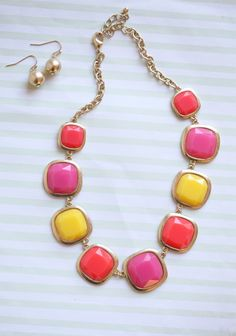 """Strawberry Lemonade Necklace 22.99 at shopruche.com. Add a statement accessory to your collection with this vibrantly colored necklace. Finished with golden hardware and matching earrings.  8.5"""" length,  Pendant:1.2"""" length, Earrings: 0.75"""" length"""