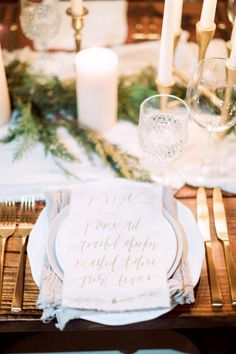 Calligraphy and handcrafted table decor details. Gold Flatware.  Photography : Hunter Ryan Photo Read More on SMP: http://www.stylemepretty.com/living/2016/12/09/a-cozy-candlelit-holiday-gathering/