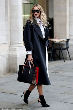 Monochrome magic: Elle Macpherson looked eternally stylish in an effortlessly chic ensemble as she headed out in London on Tuesday