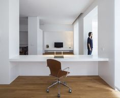 Love the clean minimalist lines if this contemporary home office and living room