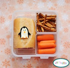 She had a turkey sandwich on a bun with a cute little penguin cut out of mozza cheese and decorated with food safe markers. She also had a container of baby carrots and a container of pretzel sticks.