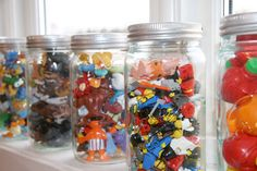 Clear jars or canisters for tiny toys. Maybe plastic instead of glass for smaller kids. (As soon as Carter gets moving, we're going to have to do this with all of TJ's little pieces.)