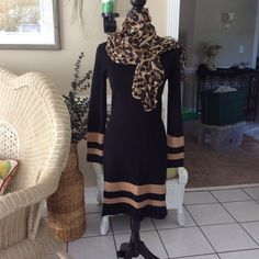 Sweater dress Great looking black acrylic sweater dress.  Very sexy and slimming.  Long sleeves with tan stripes on collar, sleeves and bottom in great condition. styleworks Dresses Maxi