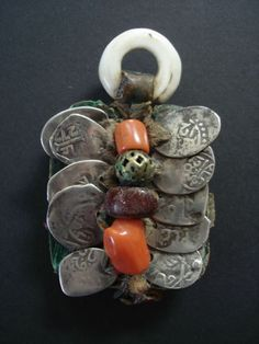Foun Zguid Talisman | Tuareg tooled leather with shell coins & beads.