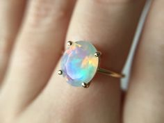 Faceted Ethiopian Opal Ring - 14k rose gold opal ring - faceted welo opal ring - opal engagement ring - 14k gold opal ring by theBEAline on Etsy https://www.etsy.com/ca/listing/253802193/faceted-ethiopian-opal-ring-14k-rose