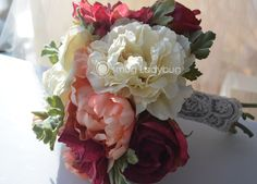 Bridal silks bouquet with burlap stem wrap and lace overlay