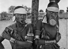 Mursi village of Dargui in Mago National Park, near Jinka, Ethiopia, 2007. The Mursi and the Surma women are the last remaining women in the world known to wear lip plates. (Image: © Sebastião Salgado/Amazonas Images/nbpictures)
