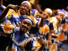 ... dance to the African Heritage Drummers during a Kwanzaa