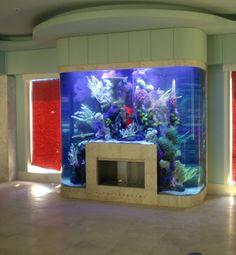 Aquarium surrounding fireplace #ideas #home #creative #fish