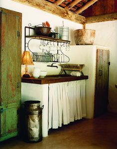 Love the dish rack/shelf over this country kitchen sink with fabric skirt.