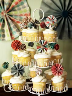 Using strips of colorful craft paper, toothpicks and a glue gun, you can create cupcake pinwheel toppers. For a vintage twist, personalize your cupcake toppers with antique buttons — maybe a few from your mother's wedding dress. Learn how to make these. Design by Kellan Studios.