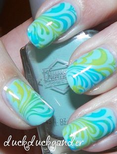I have to do this... Water Marble nail art. It's so cool and easy to do!
