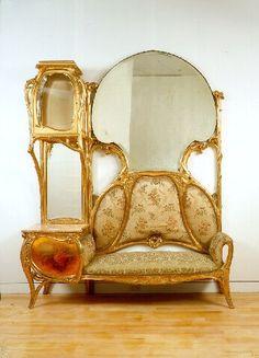 "Antonio Gaudi (1852-1926) - Palacio Guell Settee. Carved and Gilt Wood with a Mirror. Circa 1885-1889. 100"" x 78"" x 23"" (254cm x 198.1cm x 58.4cm)."