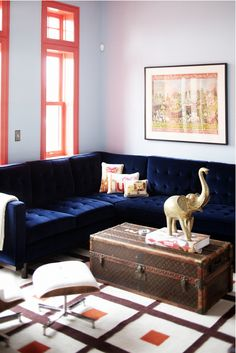 The corner of that blue velvet sofa is calling my name....with a good book...and a cup of tea...