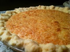 French Coconut Pie     1 stick butter (melted)  1-1/2 cups sugar  Pinch salt  3 eggs  1-1/2 to 2 cups coconut (package or canned)  1 tablespoon vinegar  1 teaspoon vanilla  Mix all ingredients in order, pour into unbaked pie crust.  Bake at 300 degrees about an hour or until done.  Don't overcook